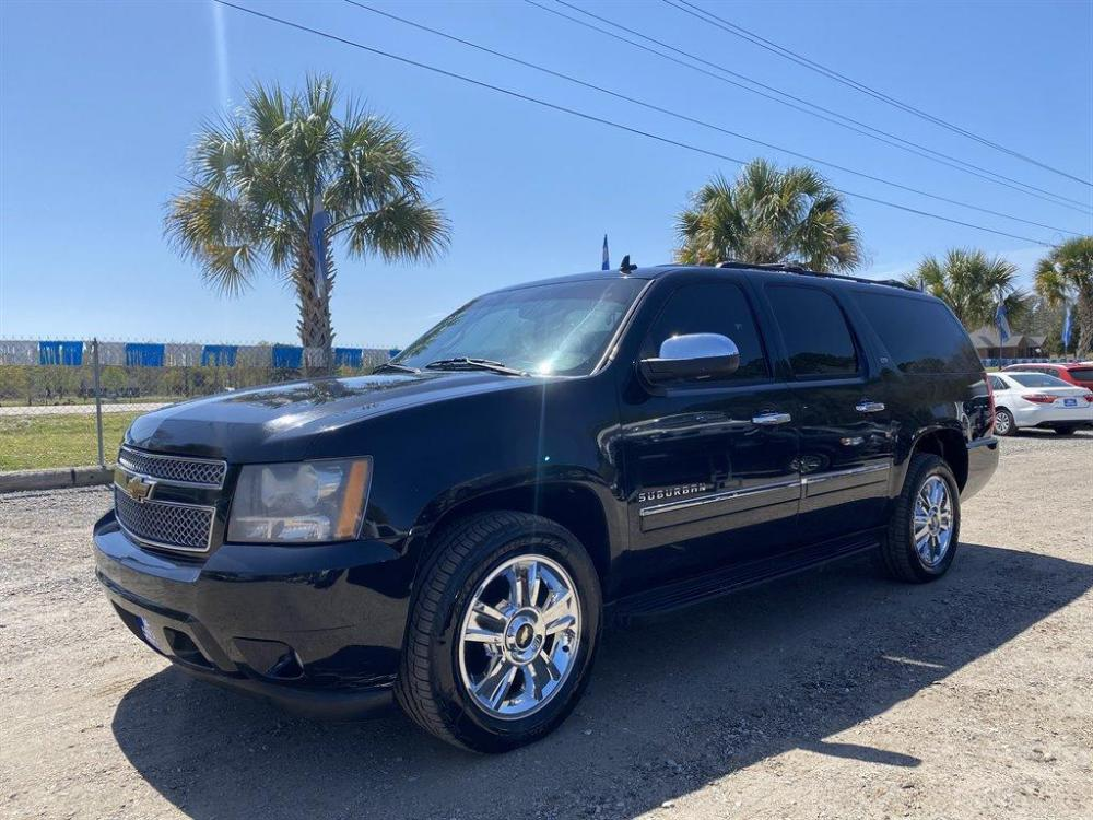 2010 Black /Black Chevrolet Suburban (1GNUKKE36AR) with an 5.3l V8 SFI Flex 5.3l engine, Automatic transmission, located at 745 East Steele Rd., West Columbia, SC, 29170, (803) 755-9148, 33.927212, -81.148483 - Photo #0