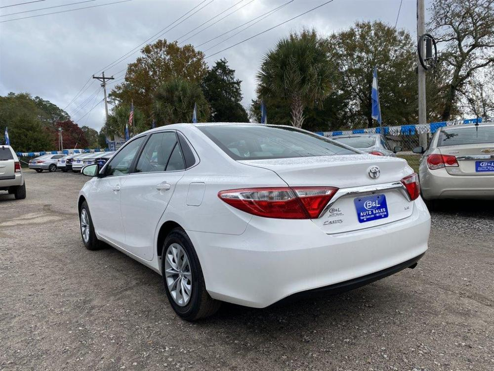 2016 White /Grey Toyota Camry (4T1BF1FK8GU) with an 2.5l I-4 SFI Dohc VVT-I 2 engine, Automatic transmission, located at 745 East Steele Rd., West Columbia, SC, 29170, (803) 755-9148, 33.927212, -81.148483 - Photo #1